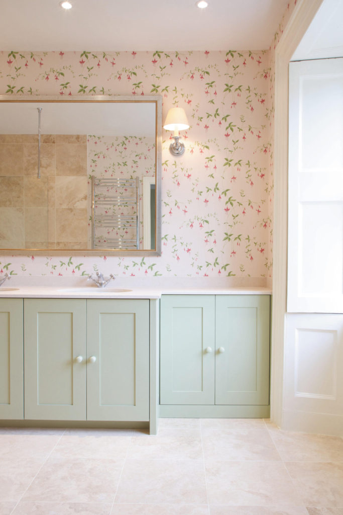 Muted tones and Colefax & Fowler wallpaper in a muted bathroom